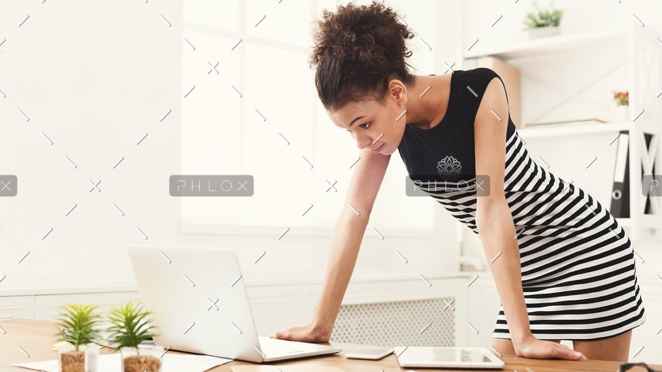 demo-attachment-115-business-woman-working-on-laptop-at-office-PRFJKQJ